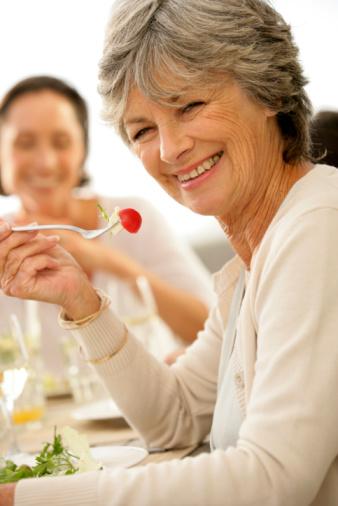 older lady eating strawberry